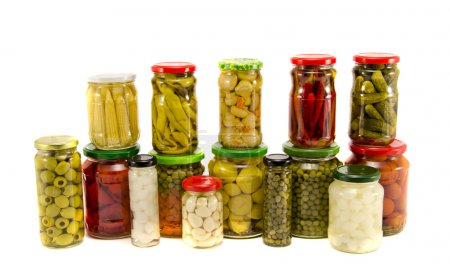 collection canned vegetables in glass jars isolated