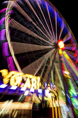 Abstract long exposure picture of highlighted giant ferris wheel in Prater Amusement Park in Vienna