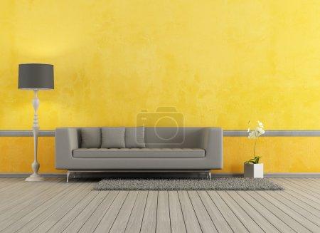 Photo pour Canapé moderne gris dans un salon jaune - rendu - image libre de droit