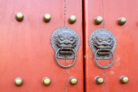 Metal Knocker on the door in the Forbidden City in Beijing, chin