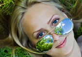 Summer reflection in sunglasses of woman