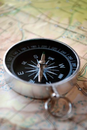 Handheld compass on a map