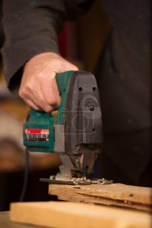 Elderly carpenter working in his workshop