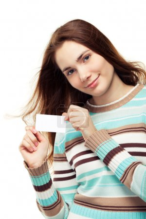 Photo for Beautiful young woman in a striped sweater holding a blank business card, isolated on white - Royalty Free Image
