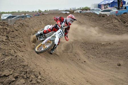 Motocross rider veering point-blank of clay
