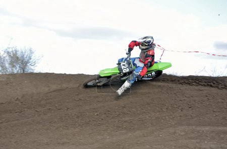 Motocross rider veering point-blank with proslipping