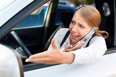 Photo for Young angry woman in traffic jam - Royalty Free Image