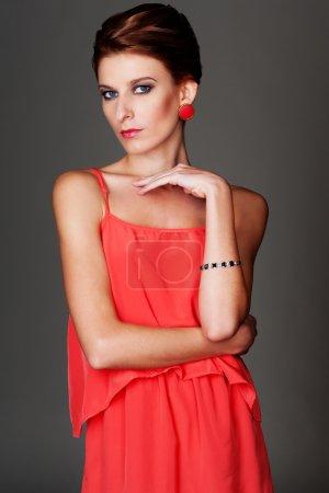 alluring female in red dress