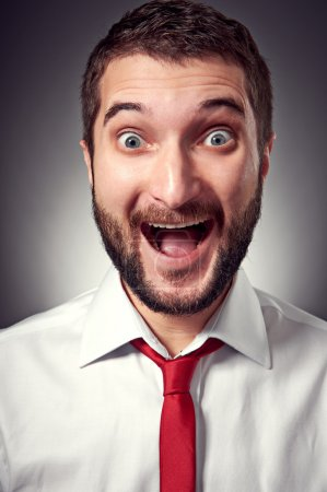 excited young man with beard