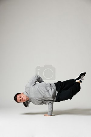 cool b-boy standing on one hand