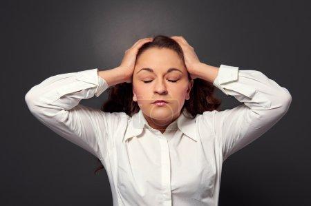 tired woman have a headache