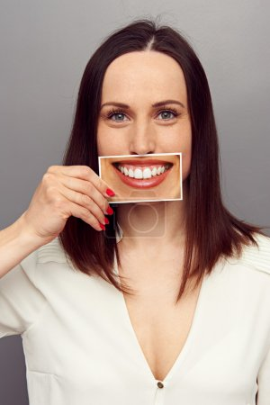 Woman hiding her emotions behind smile