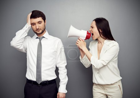woman shouting in megaphone at the tired man