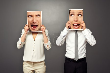 Man and woman holding screaming faces. concept pho...