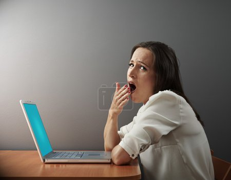 boring woman sitting with laptop
