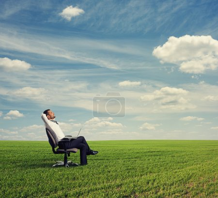 Man resting on the green field