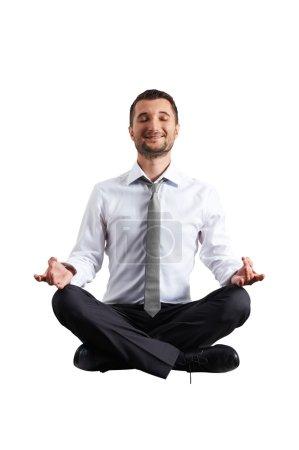 man in formal wear practicing yoga