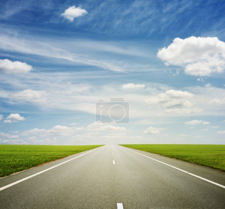 Photo for Beautiful view of roadway, green field and blue sky - Royalty Free Image