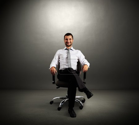 Boss sitting on chair