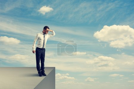 Man standing on the edge and looking down