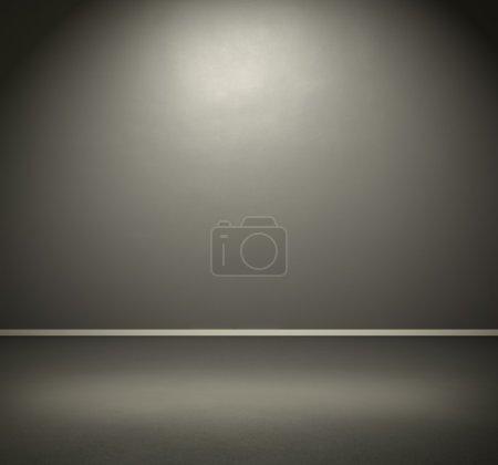 room with dark grey wall and floor