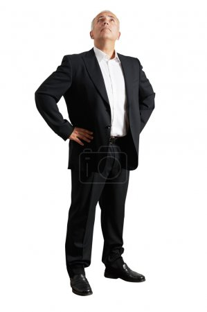 businessman in black suit looking up