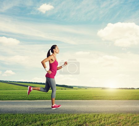 Photo for Runner woman jogging in countryside - Royalty Free Image