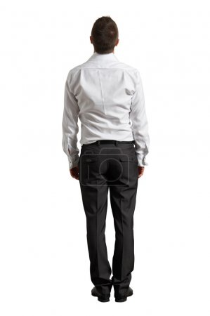 Back view of businessman looking up