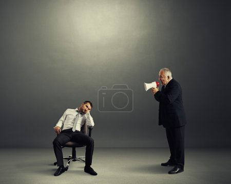 boss screaming at lazy worker