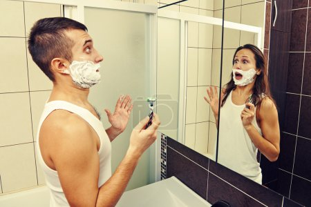 amazed man shaving