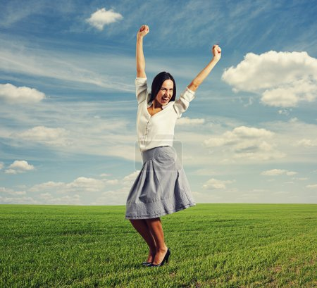 Photo for Happy young woman raising hands up and laughing - Royalty Free Image