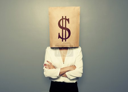 Woman hiding under paper bag with dollar sign