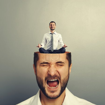 Photo for Portrait of stressed young man with open head. calm businessman sitting in yoga asana and smiling in the man's head. photo over grey background - Royalty Free Image