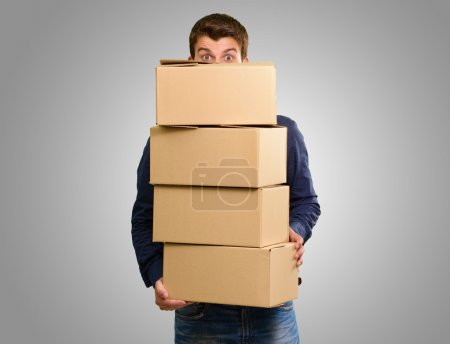 Man holding cardboard boxes