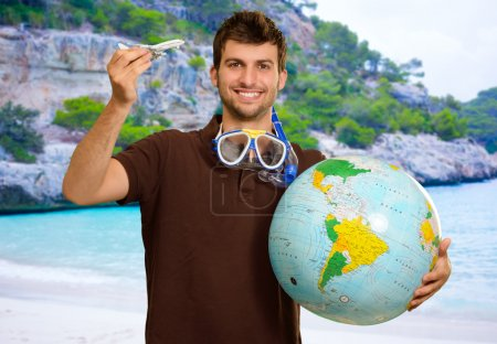 Man Holding Globe And Airplane