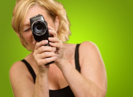 Woman Looking Through Camera