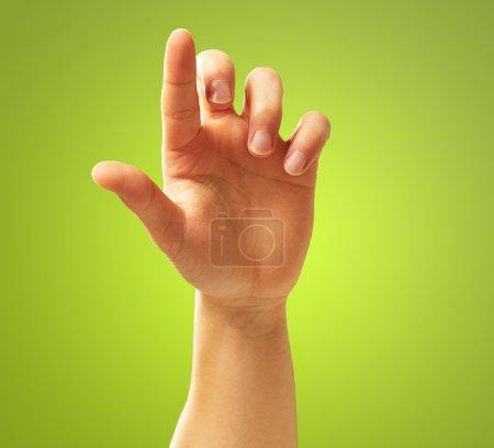 Photo pour Geste main humaine sur fond vert - image libre de droit
