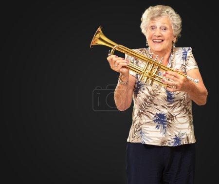 Portrait Of A Senior Woman Holding A Trumpet