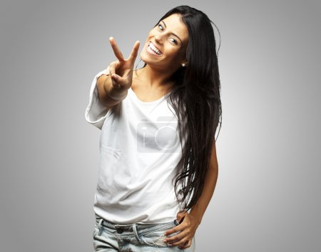 Happy Young Woman Showing Victory Sign