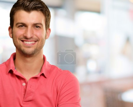 Photo for Portrait of young man smiling, background - Royalty Free Image