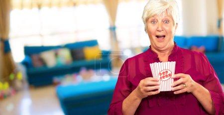 Old Woman Eat Popcorn