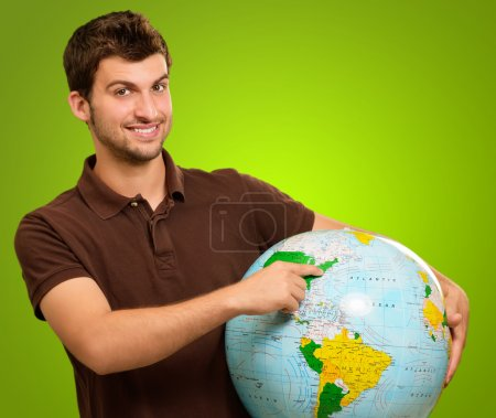 Young Man Holding Globe