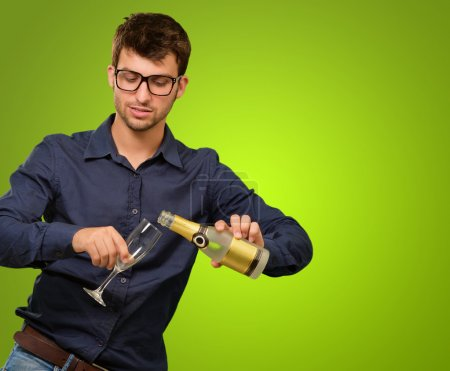 A Young Man Pouring Champagne