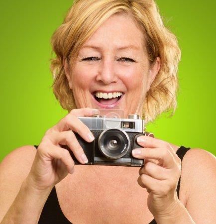 Happy Mature Holding Camera