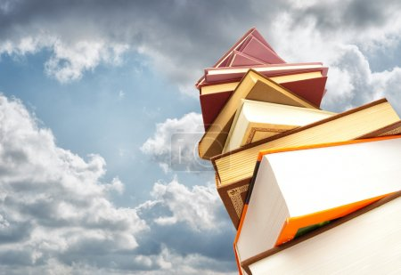 Photo for Stack Of Books Against Blue Sky - Royalty Free Image