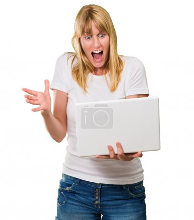 Shocked Woman Looking At laptop