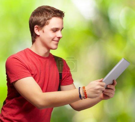 casual man holding digital tablet