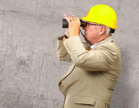Senior Architect Looking Through Binoculars