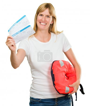Portrait Of A Happy Woman Holding Boarding Pass And Lifejacket