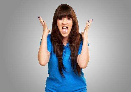 Photo for Portrait of a teenager screaming and angry on gray background - Royalty Free Image
